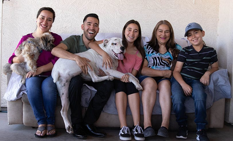 healthcare rising arizona members at home with family and dogs